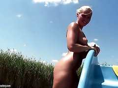 Blonde Kathia Nobili shows it all in a tempting manner