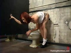 Redhead snatch is being drilled in the toilet