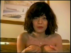 Mature brunette Metto shows her bushy cunt and gets facialed