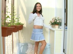 Solo model with miniskirt plays in a glass enclosed room where everyone can see!
