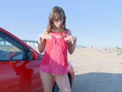 This teen likes to show off her car and her body outdoors!