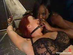 Delicious and sexy ebony is going to abuse that lusty redhead