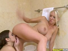 Lynn Love and her GF lick each other's coochies in a bathroom