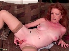 Milky white mature masturbates cunt with toy
