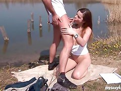 Brunette teen gets fucked and jizzed outdoors