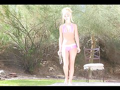 Sexy blonde reads a magazine butt naked outdoors