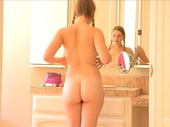 Sensual Aurielee fondles her tits and ass in front of a mirror