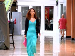Mila the Asian FTV model is showing her tits and ass in a mall