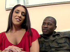 Sexy Mischa Brooks strokes a black cock in a backstage vid