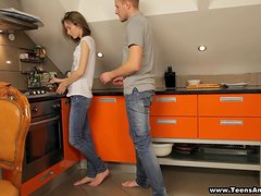A very sexy teen is getting balled in the kitchen