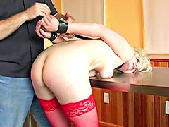 Classy blonde gets tortured in sexy red stockings