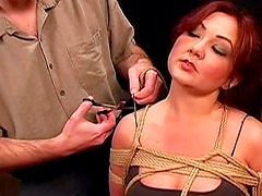 Kinky redhead dame gets tortured and bondaged