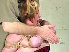 Amateur in corset gets her tits tied with rope