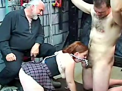 Old geezer dominates a schoolgirl and a chained guy
