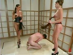 Two kinky chicks whip and toy a tied up guy in his ass