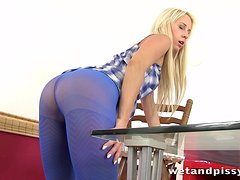 A blonde girl in pantyhose toys herself and pisses