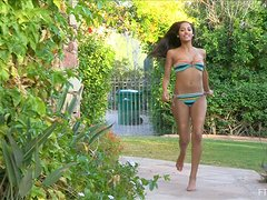 Michele demonstrates her flawless body in the garden