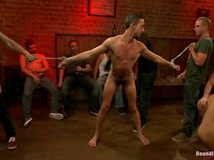 Gay bondage scene with a submissive guy