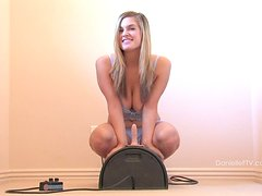 Blonde sweetie Danielle gets satisfied by a fucking machine indoors