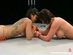 Lesbian Wrestlers Give An Exhibition On How To Dominate Rivals With An Orange Dildo!