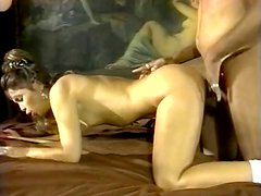 Filthy and slutt brunette whore gives a blowjob to black cock