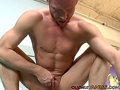 Blonde hunk stretching his anus with a BBC