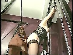 Master hits pussy of tied slave with a whip and spread her pierced cunt and plays with her clit