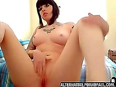 Tattoo goth girl strips infront of her webcam