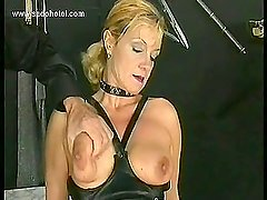 Hot and horny slave with nice tits got spanked on her pussy and boobs by master in a dungeon