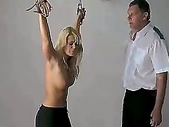 She is tied down and her ass is caned