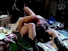 Busty bimbo in black boots performs vintage sex