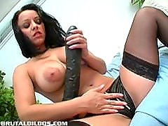 Busty Russian fills her pink pussy with a massive dildo