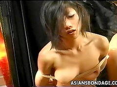 Two Asian bitches are tied up poked and prode