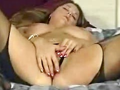 Big breasted vixen masturbates in black pantyhose
