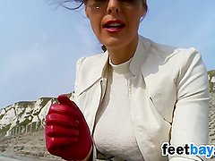 Woman In Leather Boots And Gloves