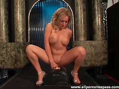 Hot fake tits chick sits on the Sybian