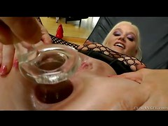 Glass plug stretches out her asshole