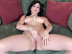 Pretty brunette with huge tits fucks herself with glass dildo