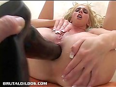 Kelly Wells asshole punished by a big dildo