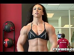 Huge Female Bodybuilder Flexing And posing At The Gym
