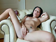 Black dildo fills tight young hole