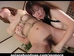 Cute Asian babe tormented by her smoking hot mistress