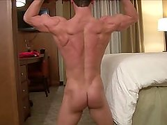 Huge cock bodybuilder flexes and jerks