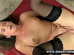 Hot lady pissing a cup with pleasure