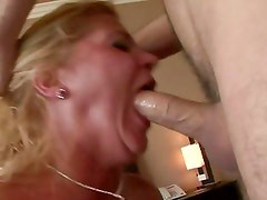 Alluring Ginger Lynn chokes on this hard throbbing cock