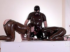 Guy fucks two chicks in their rubber holes