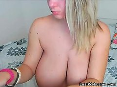 Busty cam girl plays with her hairy pussy