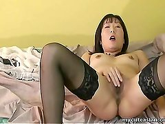 Asian mature woman in lust fingers her wet pu