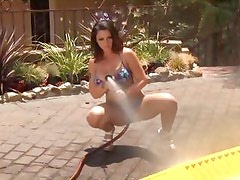 Bikini lovely Melina Mason gets wet and wild