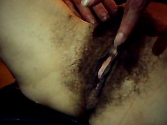 My wife playing with her milf hairy pussy